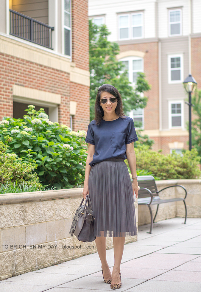 navy silky top, two-tone watch, dark gray tulle midi skirt, camo printed scarf, gray suede tote, leopard pumps