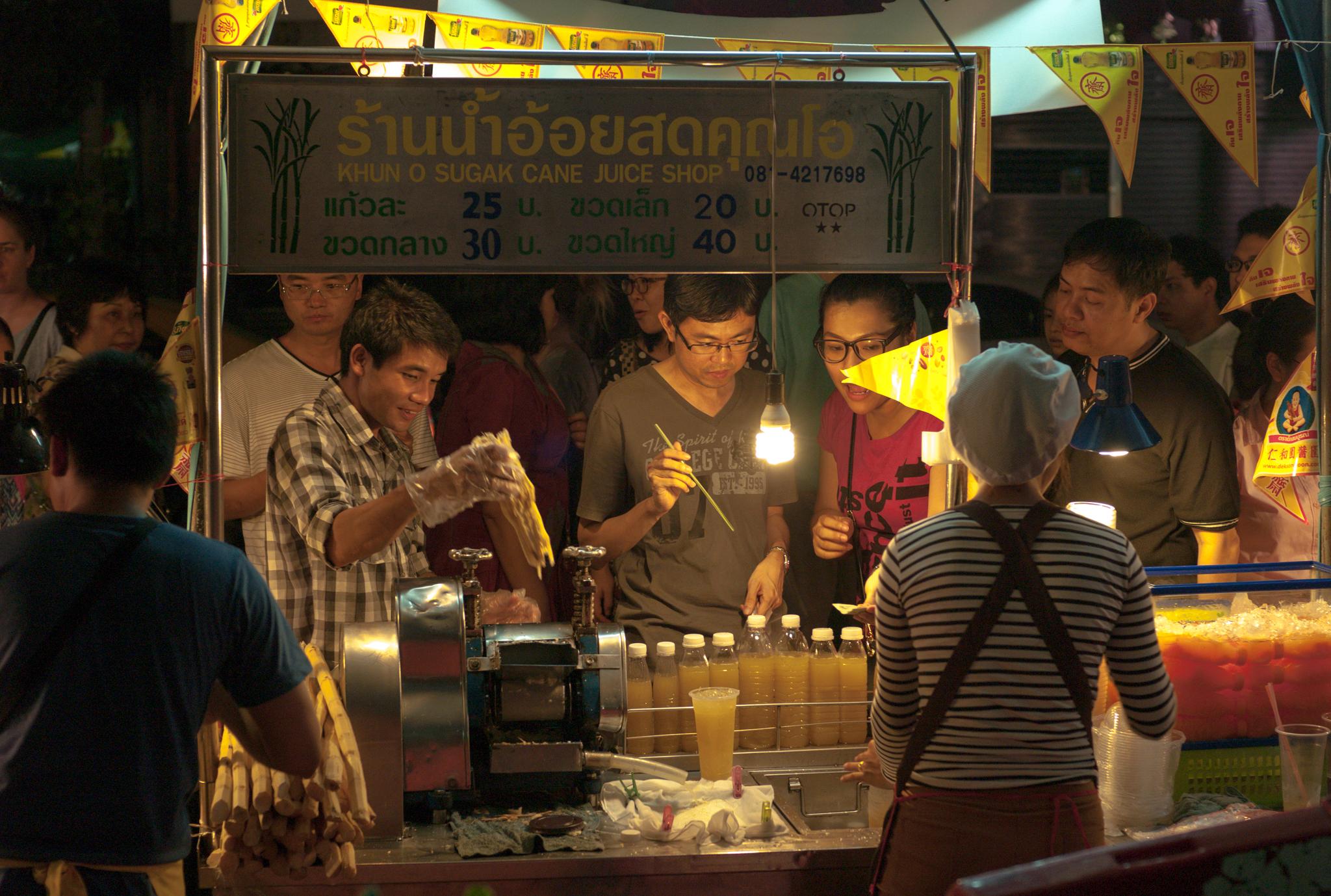 Sugarcane juice vendor in a market in Bangkok, Thailand.