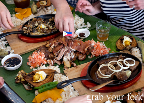 Eating with fingeres during our boodle fight at Sizzling Fillo in Lidcombe Sydney