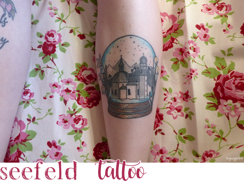 seefeld austria snow globe winter leg tattoo
