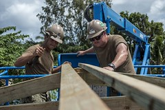 Builder 3rd Class Michael Waits, left, and Construction Mechanic 2nd Class Robert Farina assemble a roof for a Pacific Partnership engineering project in Palau, April 11. (U.S. Navy/MCSN Caledon Rabbipal)