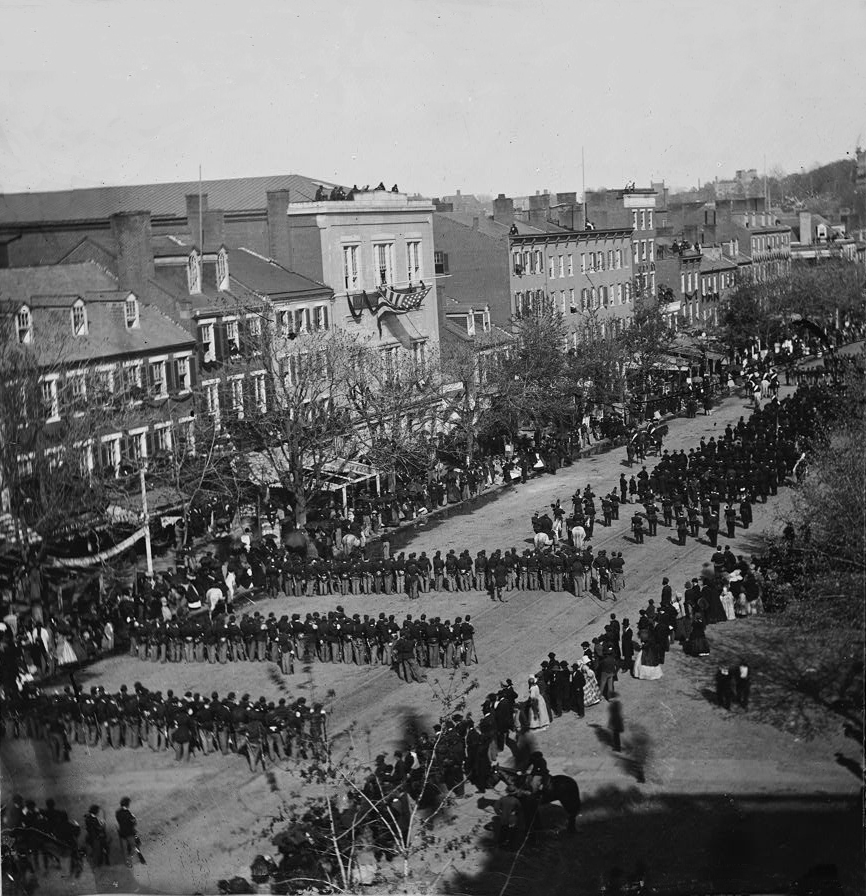 Military units marching down Pennsylvania Avenue in Washington D.C. during the state funeral for Abraham Lincoln on April 19, 1865