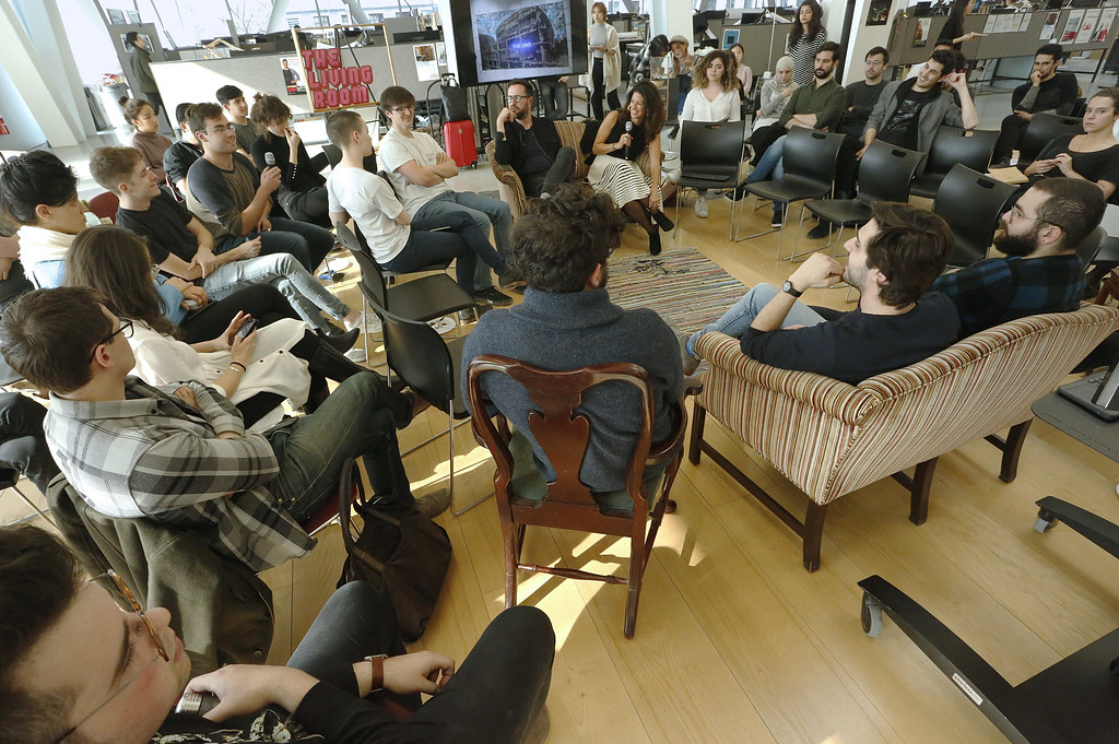 "Amira el Solh, lower left, was a guest speaker for The Living Room series event ""Amira el Solh and Derek Dellekamp: Contested Bodies in the Living Room,"" wood floor, L. P. Kwee Studios."