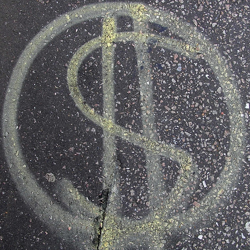 Spray painted dollar sign on street