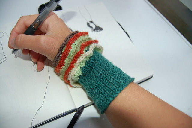 Green wrist warmers knitted