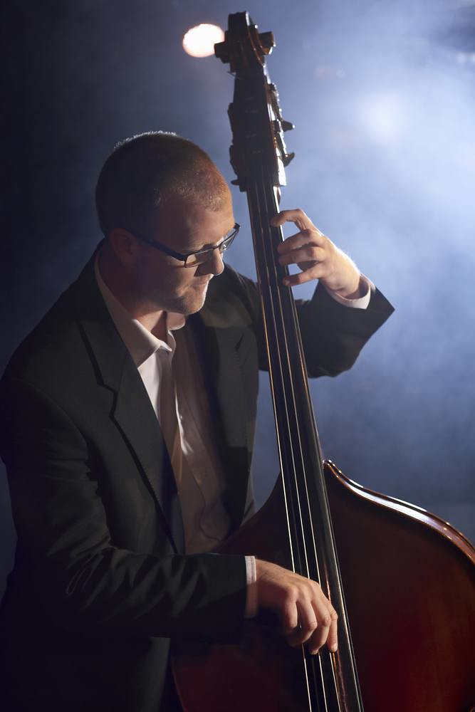 Photo of jazz musician performing on upright bass