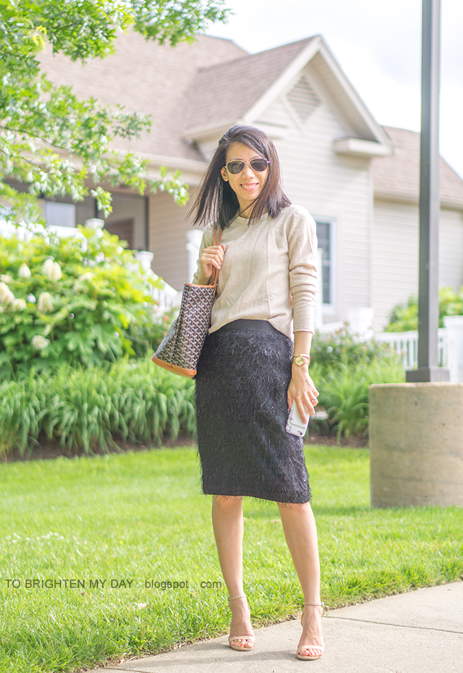 camel cashmere sweater, gold watch, gold bangle, patterned tote, black pencil skirt with fringe, nude sandals