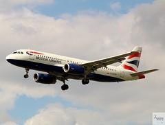 British Airways A320-232 G-EUYM landing at LHR/EGLL