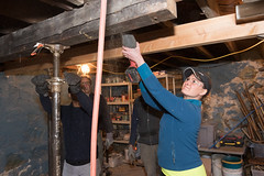 Rep. Cummings uses a Sawzall to cut through a beam being replaced in the basement of a Habitat for Humanity build in Waterbury.