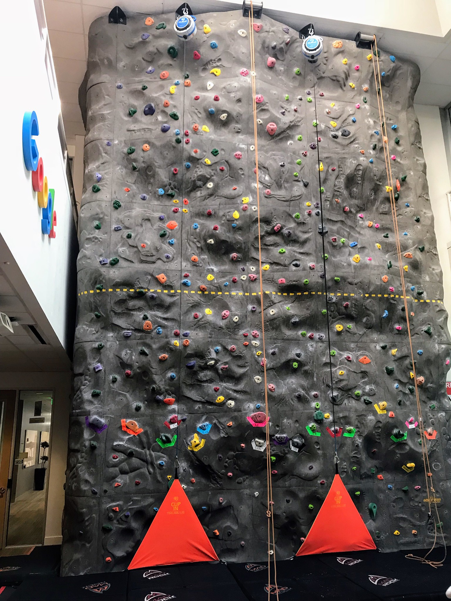 Google climbing wall with auto-belay rigs