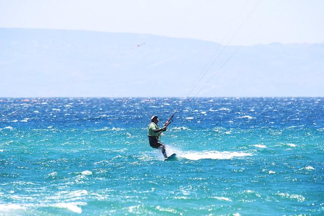 A man kitesurfing in Tarifa