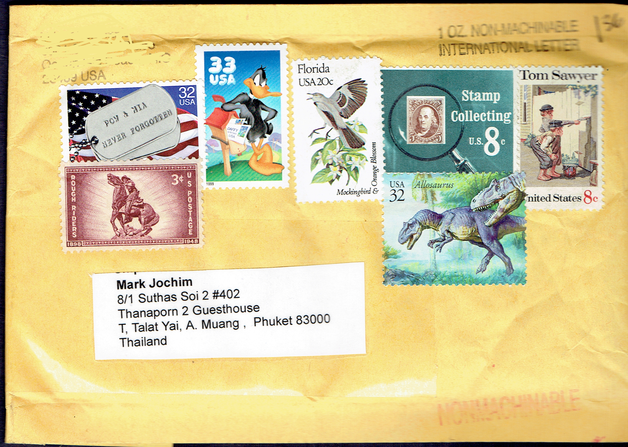 Envelope received from a stamp dealer in the United States (the packet contained stamps ordered from that dealer) on which none of the stamps received cancellations but, worse than that, many of the stamps were placed on top of other stamps...