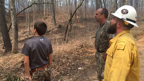 Fire management staff for the Chattahoochee-Oconee National Forests discusses a prescribed fire with wild turkey hunters.  Photo by U.S. Forest Service/Steven Bekkerus.