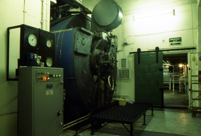 Brora Distillery on Closing Day, 1983 (Original Clynelish Distillery). Boiler Room through to Still Room. (T)