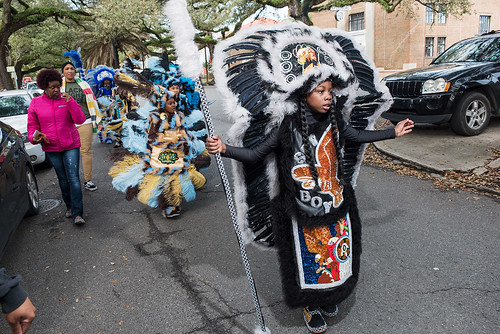 Wild Opelousas Spy Boy Kyllon Martin leds the tribe along Opelousas Avenue on Febuary 8, 2018. Photo by rhrphoto.com.