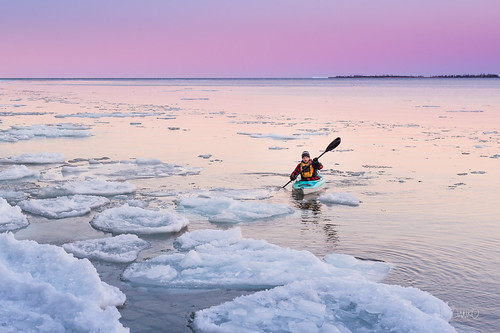 Man alone on winter kayaking adventure Ontario lake