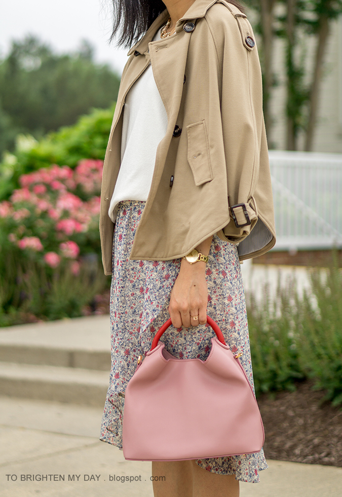trench cape, white fringe sweater tee, gold watch, floral wrap skirt, pink tote with red handle