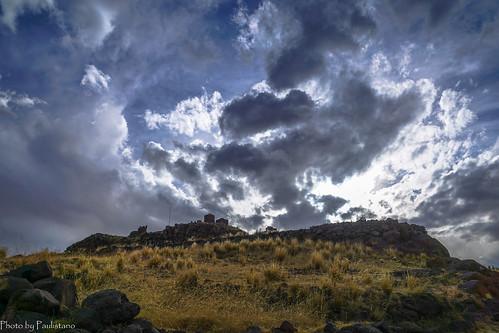 travel peru sillustani andes altiplano sky ruins ancient landscape mountain grass