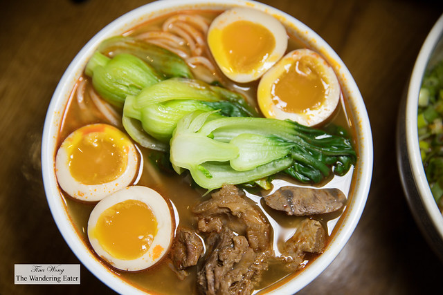 Braised Beef Noodles Soup with extra soft boiled smoked egg - Braised beef flank cooked with chili bean paste, star anise and Sichuan style spices, topped with baby bok choy and scallions