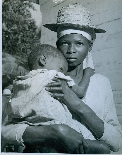 A haitian woman clutches her baby on way  to doctor