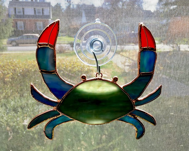 stained glass crab in the front window