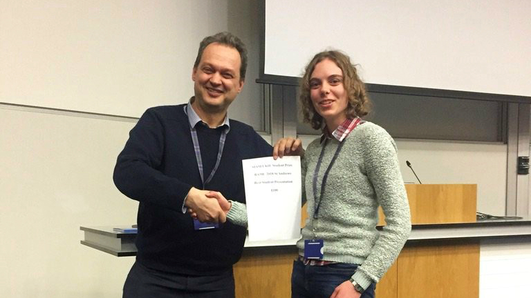 PhD student receiving a prize