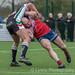 Hamish Barnes brings down Oldham's Lee Kershaw-7122