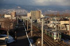 手稲山と列車