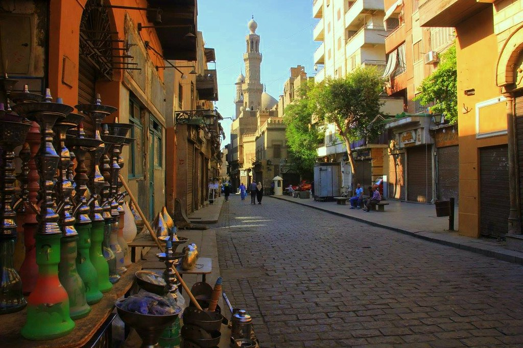 Old mingling seamlessly with the young keeping the traditions alive gives Cairo street photography its character