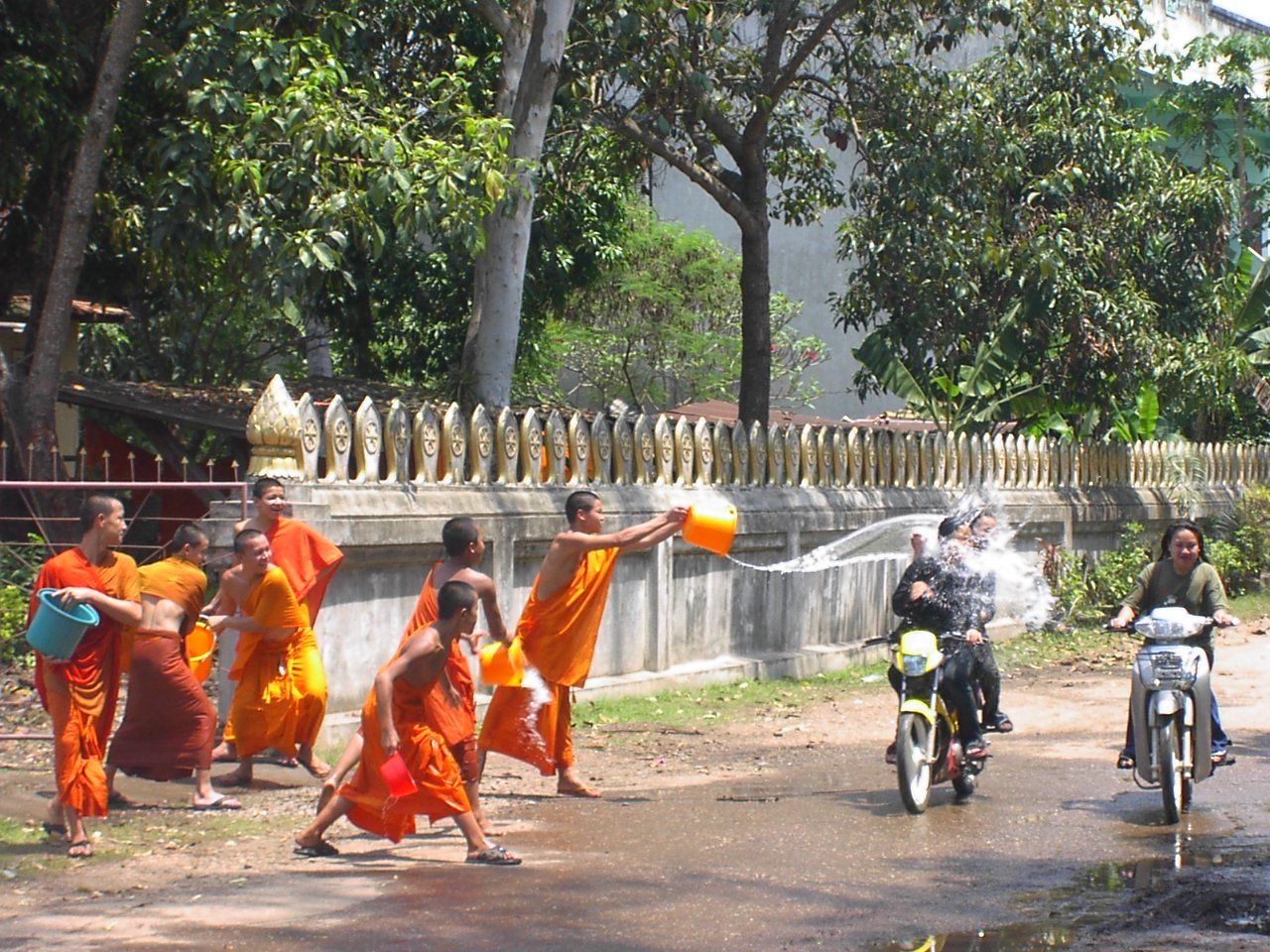 Buddhist monks participating in Songkran water-throwing. Photo taken on April 13, 2002.