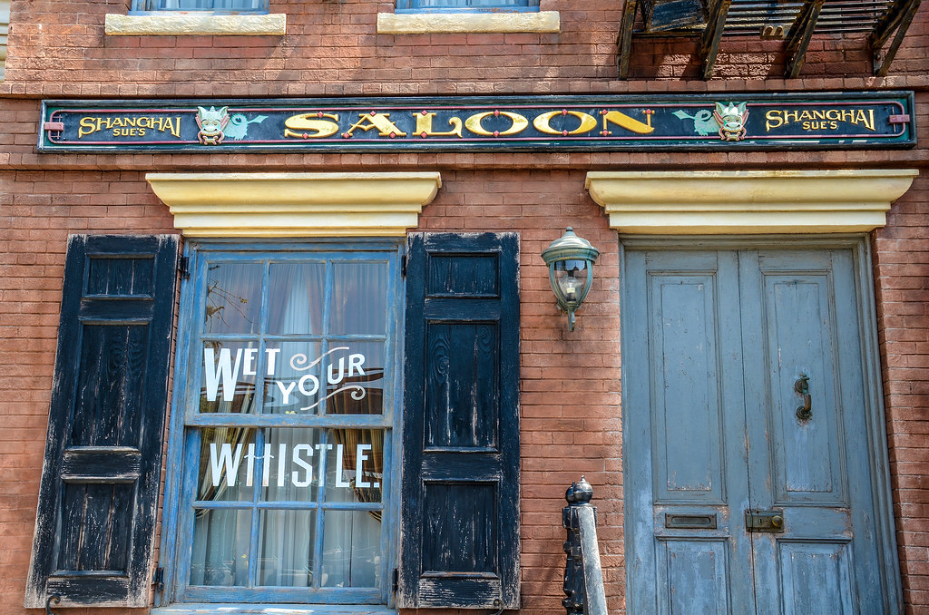 Shanghai Sue's Saloon Wet Your Whistle sign TDS American Waterfront