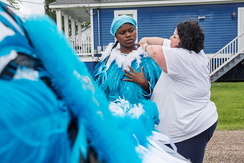 Martin Behrman Charter school Liz Arias helps student and Big Queen Regine Roberts into her suit before the West Fest parade on April 23, 2017. Photo by Ryan Hodgson-Rigsbee www.rhrphoto.com