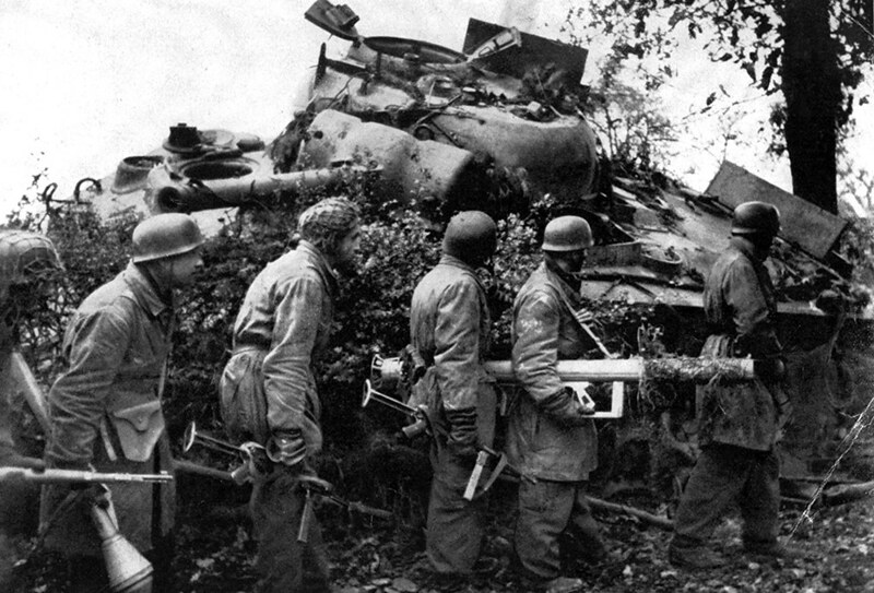 Fallschirmjäger_soldiers_and_destroyed_M4A3_Sherman_tank_1944-1