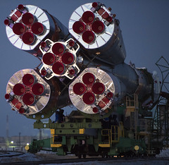 The Soyuz rocket is rolled out by train to the launch pad Friday Dec.