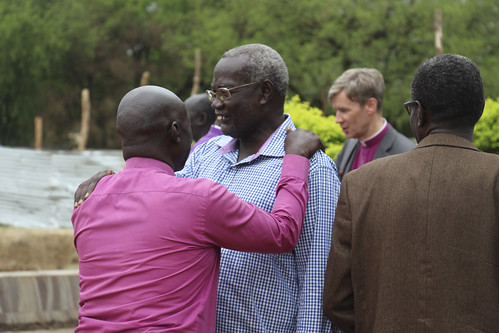 A South Sudanese bishop greets retired Archbishop Daniel Deng Bul