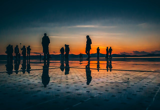 A group of people during sunset in Zadar, Croatia