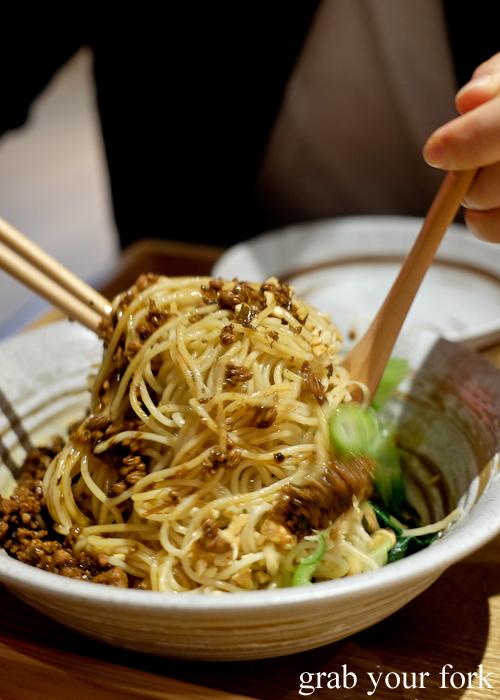 Mixing the dan dan noodles at Mr Meng Chongqing Gourmet in Market City Chinatown Sydney
