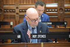 Rep. Stokes studies legislation during session on 4.10.18