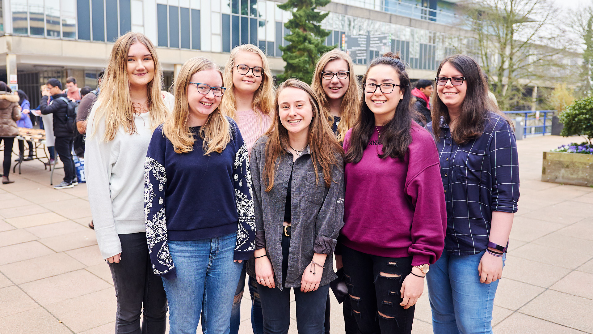 Seven female computer science students looking to camera