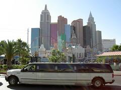 public transport(0.0), automobile(1.0), metropolitan area(1.0), vehicle(1.0), transport(1.0), skyline(1.0), land vehicle(1.0), city(1.0), luxury vehicle(1.0), limousine(1.0),