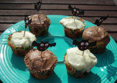 yellow cupcakes with vanilla and chocolate icing