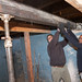 Rep. Fusco and Evens Billy support a beam while working to replace it in the basement of a Habitat for Humanity build in Waterbury.