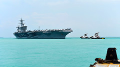 USS Theodore Roosevelt (CVN 71) approaches the pier at Changi Naval Base, April 2. (U.S. Navy/Marc Ayalin)