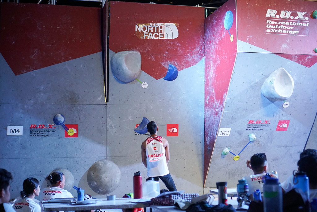 Seto (ID) studies the last problem, men's open finals, 2018 Zero Gravity International Bouldering Competition