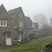 Stoneywell cottage in mid-April fog
