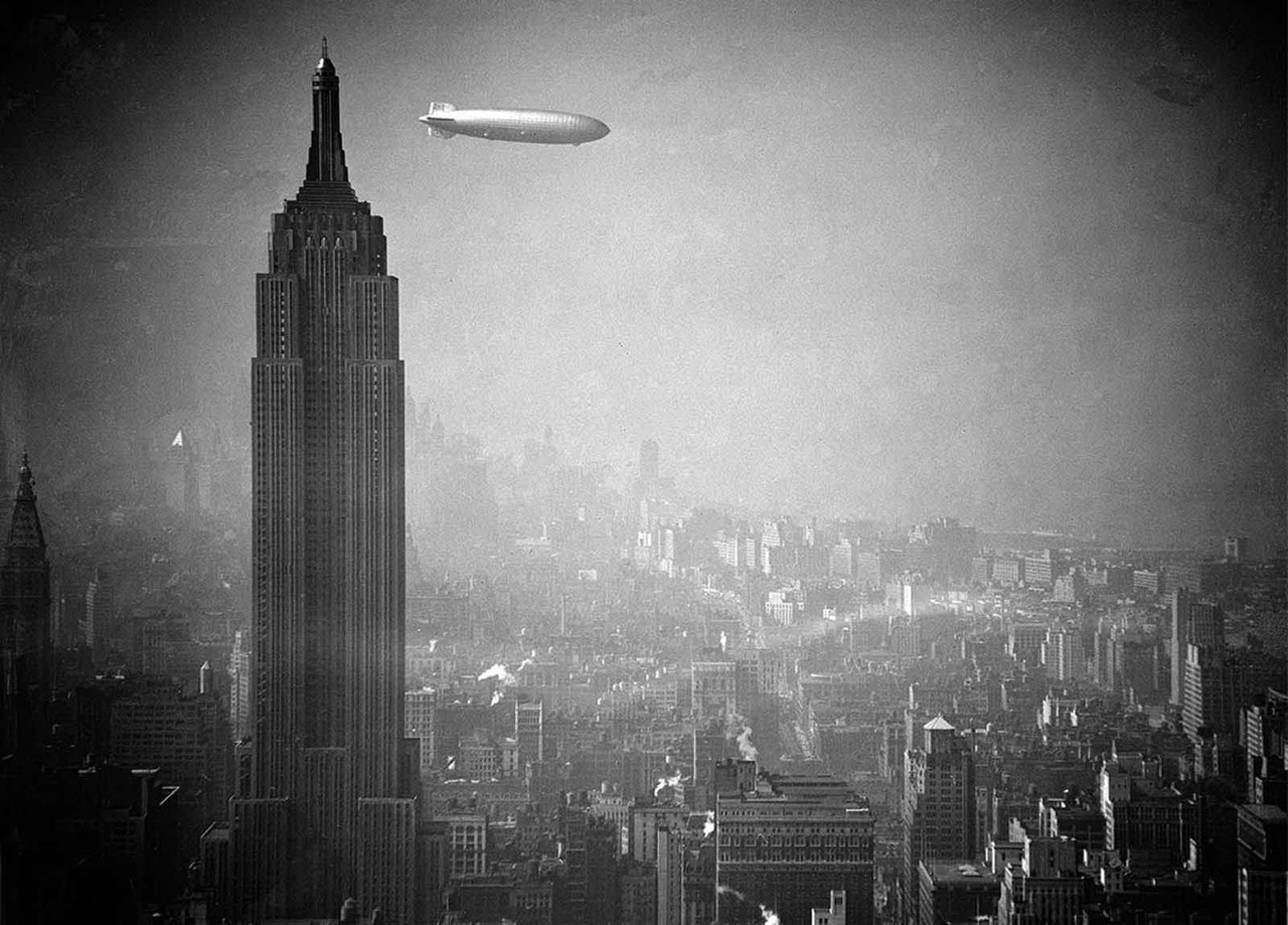a German Zeppelin floats past the Empire State Building, 1936
