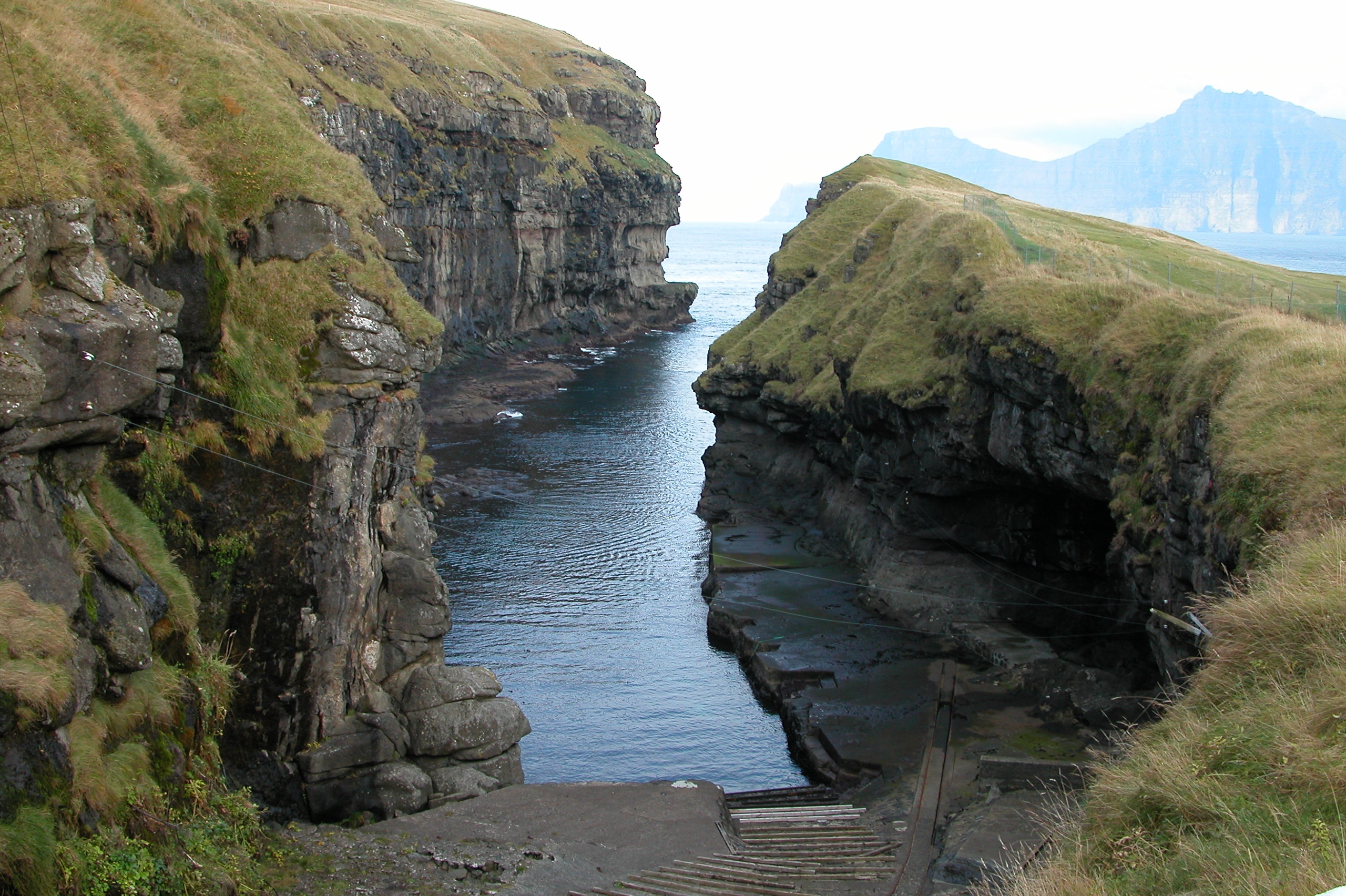 The gorge is the natural harbor of Gjógv, Faroe Islands. Photo taken on October 13, 2004.