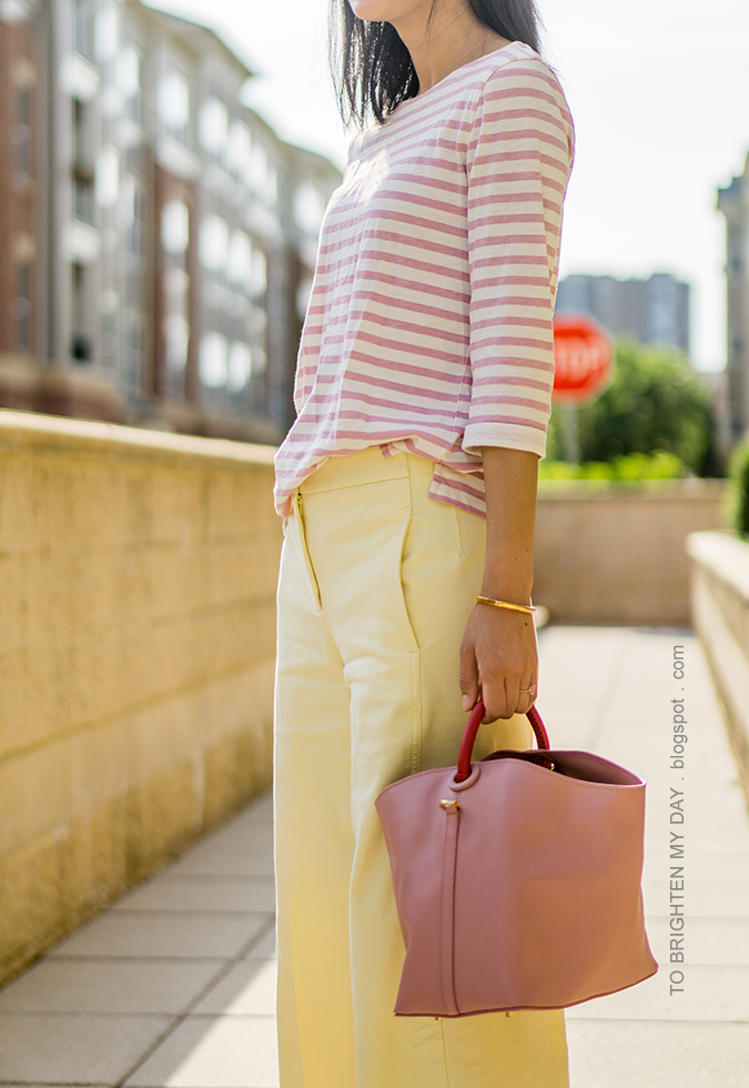 pink striped top, rose gold cuff, yellow wide leg cropped pants, pink bucket tote