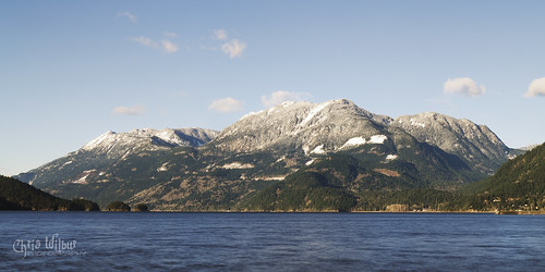 lake mountain hill snowcapped peak mount mcnair harrison hot springs bc british columbia panorama green blue canada