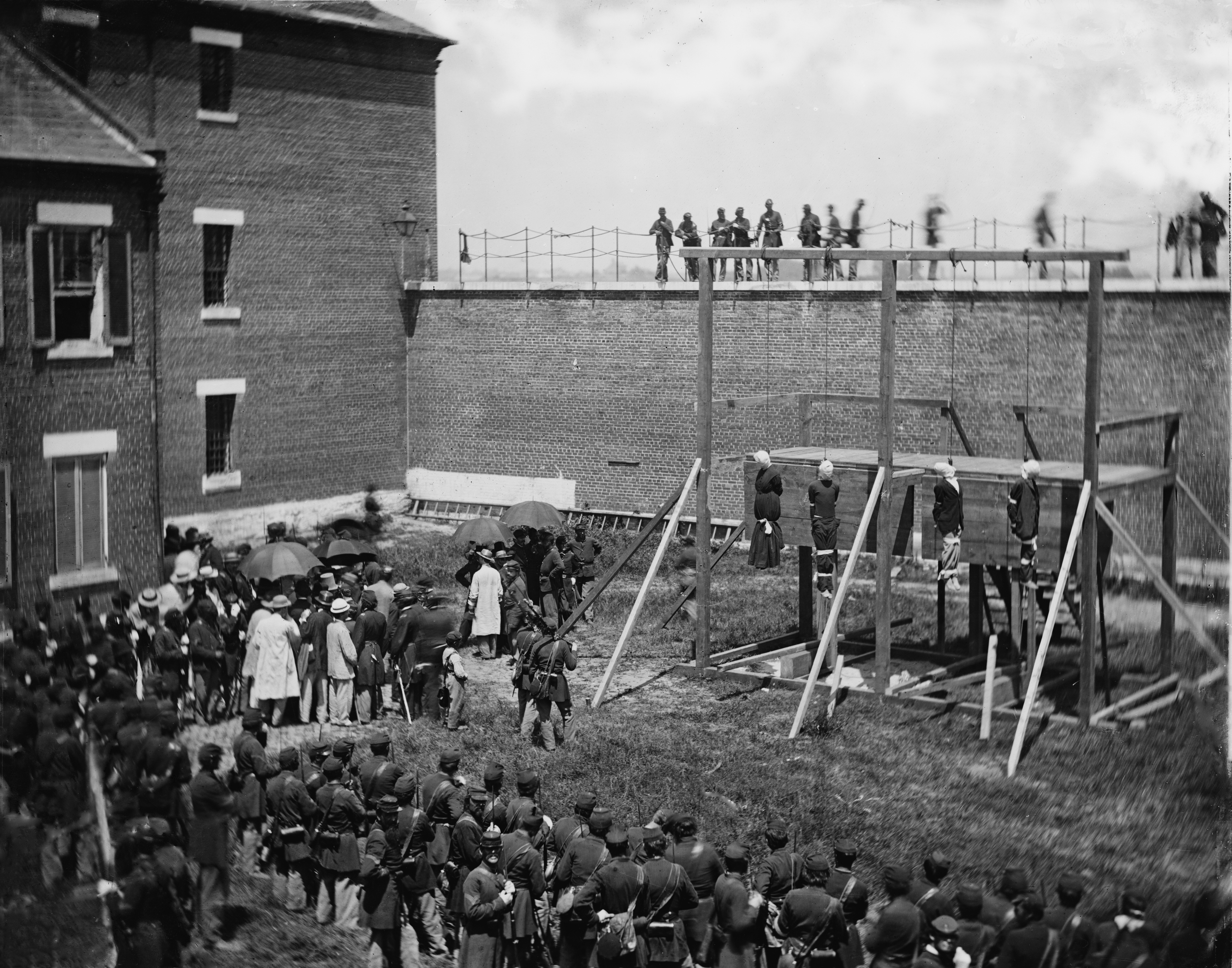 Execution of Mary Surratt, Lewis Powell, David Herold, and George Atzerodt on July 7, 1865, at Fort McNair in Washington City